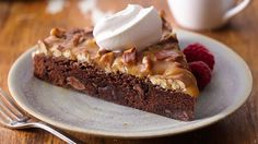 Chocolate chips in the batter and a nutty caramel topping turn basic brownies into a dazzling dessert.