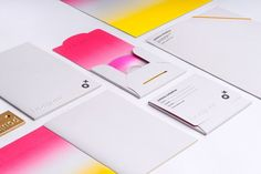 Stationery design with bright neon ink print finish and blind emboss detail created by Ostecx Créative