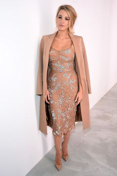 Blake Lively in a nude Michael Kors Dress, a duster, and nude pointed toe pumps.