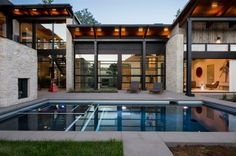 Located in the heart of Denver's Cherry Creek neighborhood and situated among a pedestrian-based urban environment, the project required a unique siting and massing approach to create a private courtyard retreat. The open floor plan is ideal for entertaining and family events as the interior gathering spaces, courtyard and pool are united through four glass garage doors and large expanses of moving glass doors and windows.