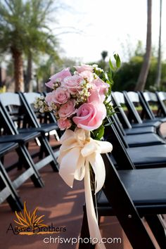 Simple pink rose arrangement for the end chair on either side of the aisle. www.agavebrothers.com #aisle #decoration #wedding #flowers #roses #agaveestates