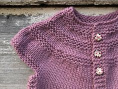 quite possibly the most beautiful baby sweater I have ever seen. I wish I coud knit like that!