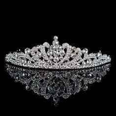 Regal Styled Silver Tiara Detailed with Shiny Rhinestones Category:TiarasOccasion:Wedding/Special Occasion/Engagement /AnniversaryMaterial:AlloyMaterial Color:Silver/GreyShown Color:SilverEmbellishment:Rhinestones/CrystalArc Length:30Height:4Diameter:13.5 Only $13.99 USD