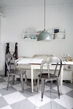 tolix chairs + painted floorboards + pendant lamp