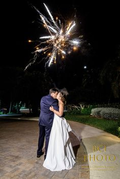 Our couple enjoy a kiss as the sparkler send off from their wedding reception at Harbour Ridge Yacht and Country Club in Pt St Lucie Florida.