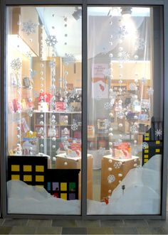 It's Snowing this Summer at Audrey's! | Skirball Cultural Center Blog. Our Ezra Jack Keats' The Snowy Day window display.