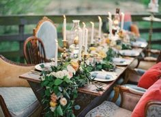 love the table garland and tall taper candles
