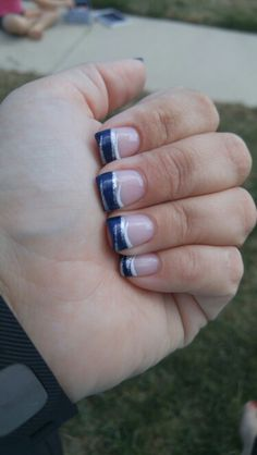Navy blue with white and silver. Tips. Gel