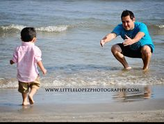 father and son pose    have son running to dad, could be in a park too
