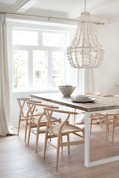 wishbone chairs, metal and wood table, shell chandelier #diningroom