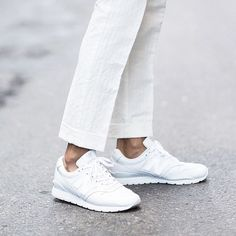 Buy light weight straight leg white pants and trainers.