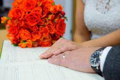 Orange wedding bouquet - contains four types of orange roses and red and orange freesias