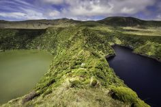 """Lajes das Flores, Flores Island, Azores, Portugal. Almost side by side, guarded by abrupt banks and separated by a sharp ridge, """"Lagoa Negra"""" (Black Lake) and """"Lagoa Comprida"""" (Long Lake) compose an interesting geographic duo. Located in the northern sector of the central plateau of the island of Flores, they're part of a set of seven lagoons nested in volcanic craters, named according to its characteristics, although, in this case, the eutrophication of """"Lagoa Negra"""" (the one in the left)…"""