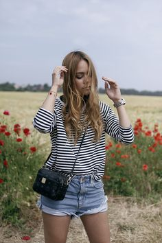 Desi is wearing a striped shirt, denim shorts and MCM bag - teetharejade.com
