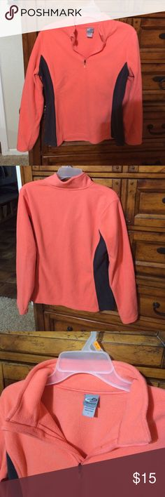 Fleece 3/4 zip up Coral with gray sides. Size large but fits me loose (i wear a medium in most clothes) warm and very comfortable. Champion Tops Sweatshirts & Hoodies