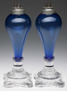 A pair of American free-blown and pressed glass whale oil lamps, Circa 1835. Provenance: Ex-collection of William J. Elsholz. George Abraham & Gilbert May. .