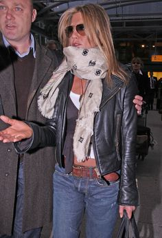 Pashmina Another day in the life of Jennifer Aniston is another day of dealing with the pesky paparazzi. Jennifer managed to keep her cool while heading into the airport and even sported a cool Louis Vuitton beige scarf.