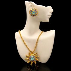 SHOW STOPPER! Striking, rare vintage Graziano sunburst pendant necklace with gorgeous blue glass stones and matching earrings. $169 From https://www.etsy.com/shop/MyClassicJewelry #myclassicjewelry #grazianojewelry #vintagejewelryset