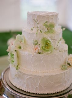 Four tiered wedding cake detail topped with sugar flowers, Jackson Hole Cake Company.  Photo by Carrie Patterson.