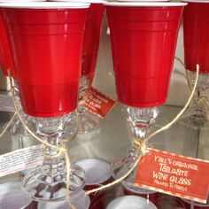 Hot glue solo cups to cheapo candlesticks.....tailgate wine glasses.