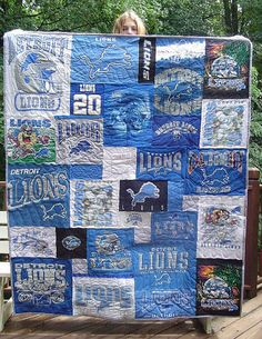 T-shirt quilt with different sized squares & each block quilted differently--picture only
