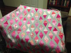"""AccuQuilt die 55409 triangle in a square. 42 different pinks 56"""" square. Made by miss 15 for a young cancer warrior"""