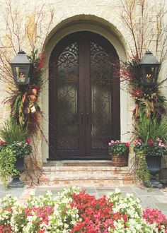 love the way they decorated the outside lighting instead of the door.