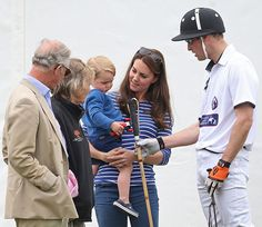 Kate Middleton, Prince William, and Prince Charles admired Prince George at the polo match on June 14.