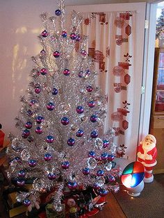 The main living rm. There's old toys underneath. Vintage Aluminum Christmas Tree, Vintage Christmas Ornaments, Modern Christmas, Christmas Tree Decorations, Christmas Holidays, Retro Christmas Tree, Christmas Mantles, Christmas Things, Victorian Christmas