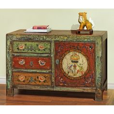 Hand Painted Tibetan Chest.  Exuberant and bold, the artwork on this cabinet displays the liveliness of Tibetan art. The distressed finish and hand painted floral designs give it a charming character and personality. Tibetan furniture.