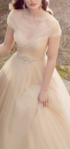 Glamorous champagne colored off-the-shoulder tulle ballgown wedding dress; Featured Dress: Essense of Australia,.... Pribly wouldnt wear it but gosh its pretty. #weddingdress #weddingshoes