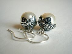 Pearl Earrings In Silver With Flower Beadcaps And by casamoda