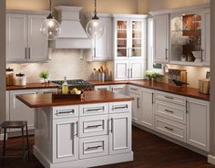 Open shelving with contrasting back in Autumn Blush creates a casual look for displaying dishes in this comfortable kitchen.