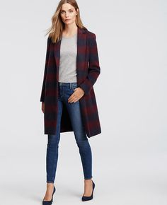 "In a luxuriously brushed wool blend, this plaid topper makes a rich and refined statement. Notched lapel. Long sleeves. Hidden snap front closure. On-seam welt pockets. Back vent. Lined. 36"" long."