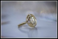The Thea engagement ring by Erika Winters with a 2.94-carat old European cut diamond in 18k yellow gold. Via Diamonds in the Library.