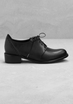 Made from fine leather, these derby shoes have brogue-style detailing behind the heel. - Almond toe- Perforated leather and serrated edges - Stacked leather heel - Cushioned leather insole and a leather outsole with rubber beneath the heel- Heel height: 4 cm