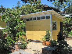 www.studio-shed.com Art Studio Shed with painted eaves - color matches the cottage style home.   #studio #shed #cave #garage #storage #hobby #art #gym #backyard #green #home #office #prefab #modular #music #backyard #retreat #design