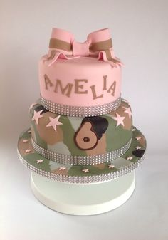 Army camoflauge cake with pink top tier and bow, and a bit of glitz