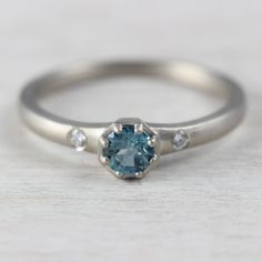 4mm Octagon Engagement Ring in 14k White Gold with side diamonds and a blue Australian diamond
