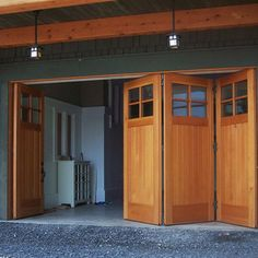 Custom Side Folding Garage Doors - The lower level of this offshore boat house was fitted with custom folding doors that allow room to maneu...