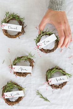 Rosemary Wreath Place Cards: Fresh rosemary sprigs add fragrance to these sweet little table wreaths. Click through for more DIY Thanksgiving place cards.