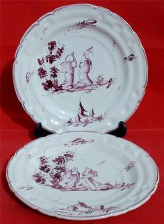 Hand Decorated Pair of Faience Plates Displaying Stylised Birds