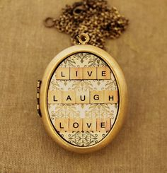 Live Laugh Love -Happy Quote Motivational Grande Photo Locket Necklace. $60.00, via Etsy.