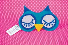 Cover a sleep mask ($1 dollar store/ $3; drugstores) with felt in the shape of an owl's face. Print party details on card stock and attach to mask with ribbon.  Download Owl Eye Mask Template