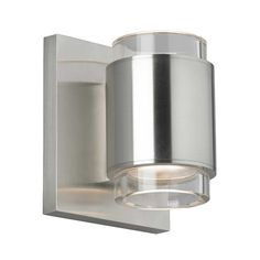 Voto Round Wall Sconce features a handsome die-cast metal body echoed by symmetrical reveals cut from a solid piece of optically pure crystal. Available with Clear or Smoke crystal and finish in Antique Bronze, Black, Satin Nickel or White. Includes 9 watt, 560 net lumen, 3000K LED module. Downlight distribution. Dimmable with low-voltage electronic dimmer. ETL listed. ADA compliant. Suitable for damp locations. 4.3 inch width x 5 inch height x 3.9 inch depth.
