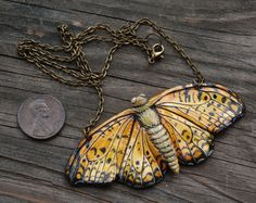 This leopard butterfly necklace is sculpted with polymer clay, hand painted with watercolor and sealed with varnish. The chain is brass plated steel.  All of my work is 100% handmade and one of a kind, there are no duplicates. However if you are interested in any variation, I do accept custom requests!  Anyone interested in a possible layaway arrangement, feel free to send me a message!  Pendant: 1.5 tall, 3 wide Chain: 16 long