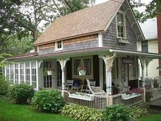Shingles, wrap around porch, sun room. I love this little house. It is a little more detailed than many but so cute for a guest cottage!