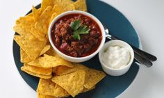 Oregano, chilli and cumin spice up this easy chilli con carne. Use beef mince for economy and make it stretch by adding kidneys beans - they'll give an extra protein hit, too!
