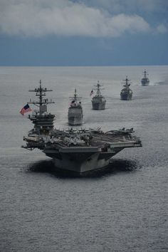 ATLANTIC OCEAN (Sept. 23, 2014 )  The aircraft carrier USS Theodore Roosevelt (CVN 71) leads a formation of ships from Carrier Strike Group (CSG) 12 during a maneuvering exercise.
