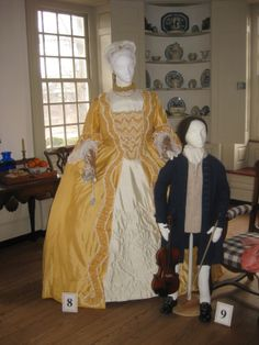 Reproduction costumes: To be 'dressed' in the 18th century signified wearing a formal ensemble, correct for an elegant dinner, reception or ball; 'un-dress' was everything else – clothing appropriate for daytime or informal wear. For the majority of the century, a favorite style was the robe à la française (or as it was known in England, the sack-back dress), a design which evolved from the late 17th century mantua.